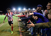 Lincoln City's Josh Ginnelly celebrates the win with fans at the end of the game<br /> <br /> Photographer Chris Vaughan/CameraSport<br /> <br /> Vanarama National League - Lincoln City v Chester - Tuesday 11th April 2017 - Sincil Bank - Lincoln<br /> <br /> World Copyright &copy; 2017 CameraSport. All rights reserved. 43 Linden Ave. Countesthorpe. Leicester. England. LE8 5PG - Tel: +44 (0) 116 277 4147 - admin@camerasport.com - www.camerasport.com