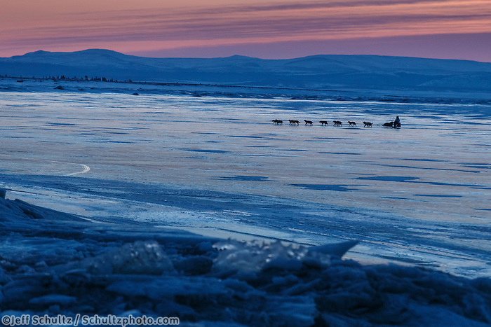 Michelle Phillips crosses Norton Sound a dawn as she nears  Koyuk on Monday March 10, during the Iditarod Sled Dog Race 2014.<br /> <br /> PHOTO (c) BY JEFF SCHULTZ/IditarodPhotos.com -- REPRODUCTION PROHIBITED WITHOUT PERMISSION