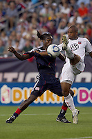 DC United defender Julius James (2) clears away pass to New England Revolution midfielder Shalrie Joseph (21) close to the net. The New England Revolution defeated DC United, 1-0, at Gillette Stadium on August 7, 2010.