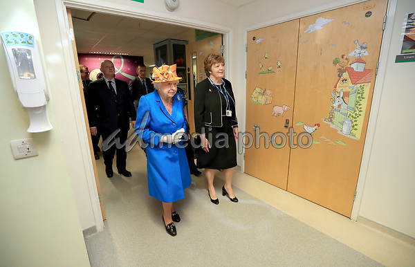 25 May 2017 - Queen Elizabeth II during a visit to the Royal Manchester Children's Hospital to meet victims of the terror attack in the city earlier this week and to thank members of staff who treated them, Escorted by Kathy Cowell Chairman of the Central Manchester University Hospital. Photo Credit: ALPR/AdMedia