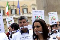 Roma, 27 Aprile 2015<br /> Manifestazione con flash mob di Ialia Unica contro la legge elettorale in discussione alla Camera dei Deputati.<br /> No Italicum, legge cerotto.<br /> Manifestanti indossano un bavaglio.