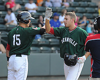 Outfielder Drew Turocy (28) of the Greenville Drive, right, is congratulated by Jordan Weems (15) after scoring a run in a game against the Asheville Tourists on Sunday, August 26, 2012, at Fluor Field at the West End in Greenville, South Carolina. Greenville won, 5-4. (Tom Priddy/Four Seam Images)