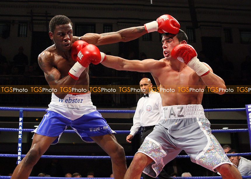 Tony Randell (Birmingham, blue/white shorts) defeats Tarik Quaddus (Peterborough, white shorts) in a Super-Middleweight boxing contest at York Hall, Bethnal Green promoted by Frank Warren / Sports Network - 21/11/08 - MANDATORY CREDIT: Gavin Ellis/TGSPHOTO - Self billing applies where appropriate - 0845 094 6026 - contact@tgsphoto.co.uk - NO UNPAID USE.
