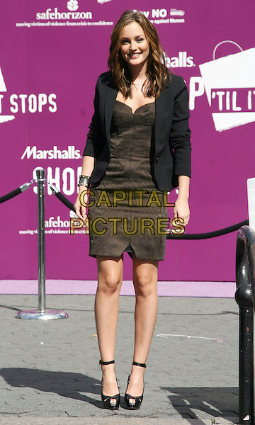 LEIGHTON MEESTER .Marshall's SHOP TIL IT STOPS fundraiser to benefit domestic violence awareness & advocacy programs.in Union Square Park, New York, NY, USA, October 2nd 2008..full length black dress wavy hair highlights shoes ankle strap peep toe microphone jacket blazer .CAP/LNC.©LNC/Capital Pictures
