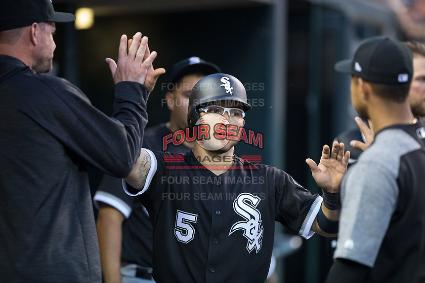 Yolmer Sanchez (5) of the Chicago White Sox high fives his teammate after scoring a run during the game against the Detroit Tigers at Comerica Park on June 2, 2017 in Detroit, Michigan.  The Tigers defeated the White Sox 15-5.  (Brian Westerholt/Four Seam Images)