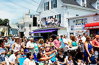 People watch the Sunday Procession during St. Peter's Fiesta in Gloucester, Massachusetts, USA.