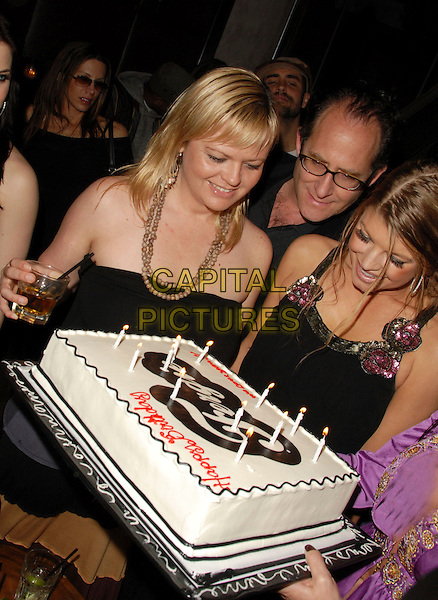 FERGIE & FRIENDS.Fergie's Birthday Party at Citizen Smith Nightclub in Hollywood , California, USA..March 28th, 2006.Ref: DVS.Stacey Ferguson Black Eyed Peas half length birthday cake candles food.www.capitalpictures.com.sales@capitalpictures.com.Supplied By Capital PIctures.