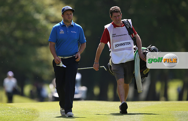 Andrew Johnston (ENG) with caddie George head to the 16th during Round One of the 2015 BMW PGA Championship over the West Course at Wentworth, Virginia Water, London. 21/05/2015Picture David Lloyd, www.golffile.ie.