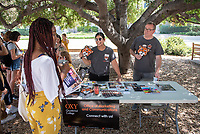 Occidental College students browse club tables at the Involvement Fair in the Academic Quad, Sept. 5, 2019. The annual event is an opportunity for students to learn about and join student-run clubs that offer a wide variety of interests.<br />
