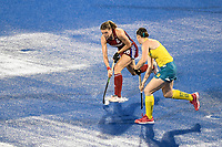 2nd February 2020; Sydney Olympic Park, Sydney, New South Wales, Australia; Womens International FIH Field Hockey, Australia versus Great Britain Women; Lily Owsley of Great Britain dribbles with the ball as Karri McMahon of Australia approaches