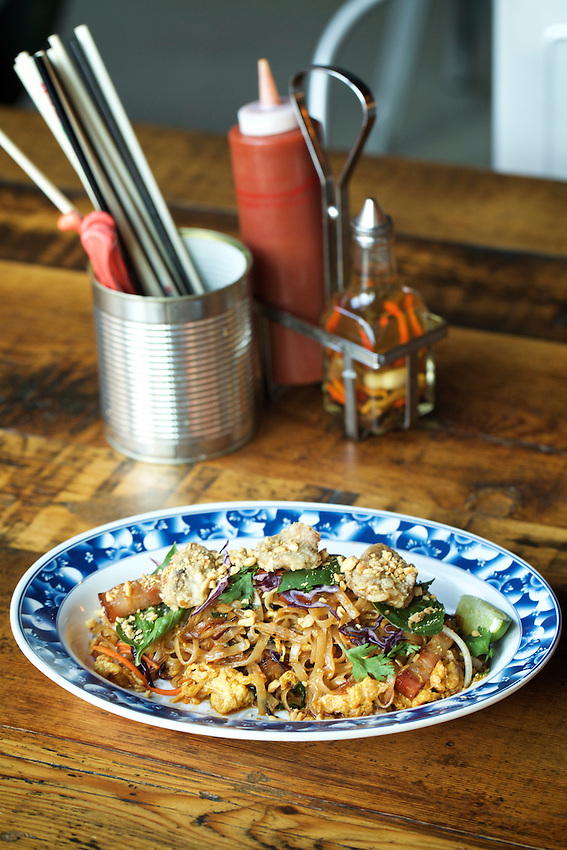 Jersey City, NJ - JANUARY 19, 2016: Crispy Oyster and Bacon Pad Thai at Talde on Erie Street, which serves chef Dale Talde's 'inauthentic' Asian-American cuisine.<br /> <br /> CREDIT: Clay Williams for Edible Jersey.<br /> <br /> &copy; Clay Williams / claywilliamsphoto.com