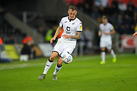 23rd November 2019; Liberty Stadium, Swansea, Glamorgan, Wales; English Football League Championship, Swansea City versus Millwall; Ben Wilmot of Swansea City chases a loose ball - Strictly Editorial Use Only. No use with unauthorized audio, video, data, fixture lists, club/league logos or 'live' services. Online in-match use limited to 120 images, no video emulation. No use in betting, games or single club/league/player publications