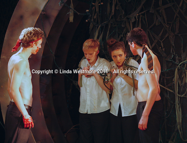 "Yvonne Arnaud Youth Theatre rehearsing ""Lord of the Flies"" by William Golding.  Mill Theatre, Guildford, Surrey."