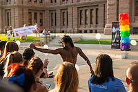 AUSTIN, TEXAS - A performer shakes hands with the crowd on the South steps of the Texas State Capitol on Saturday, Aug. 23, 2016 for the 6th Annual Stonewall Rally in observance of the 46th anniversary of the Stonewall Riots.<br />