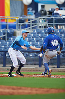 Charlotte Stone Crabs first baseman Mike Marjama (20) tags Anthony Alford (10) during a game against the Dunedin Blue Jays on July 26, 2015 at Charlotte Sports Park in Port Charlotte, Florida.  Charlotte defeated Dunedin 2-1 in ten innings.  (Mike Janes/Four Seam Images)