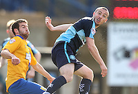 Michael Harriman of Wycombe Wanderers (right) during the Sky Bet League 2 match between Wycombe Wanderers and Mansfield Town at Adams Park, High Wycombe, England on 25 March 2016. Photo by David Horn.