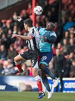 Adebayo Akinfenwa of Wycombe Wanderers goes up with Shaun Pearson of Grimsby Town during the Sky Bet League 2 match between Grimsby Town and Wycombe Wanderers at Blundell Park, Cleethorpes, England on 4 March 2017. Photo by Andy Rowland / PRiME Media Images.