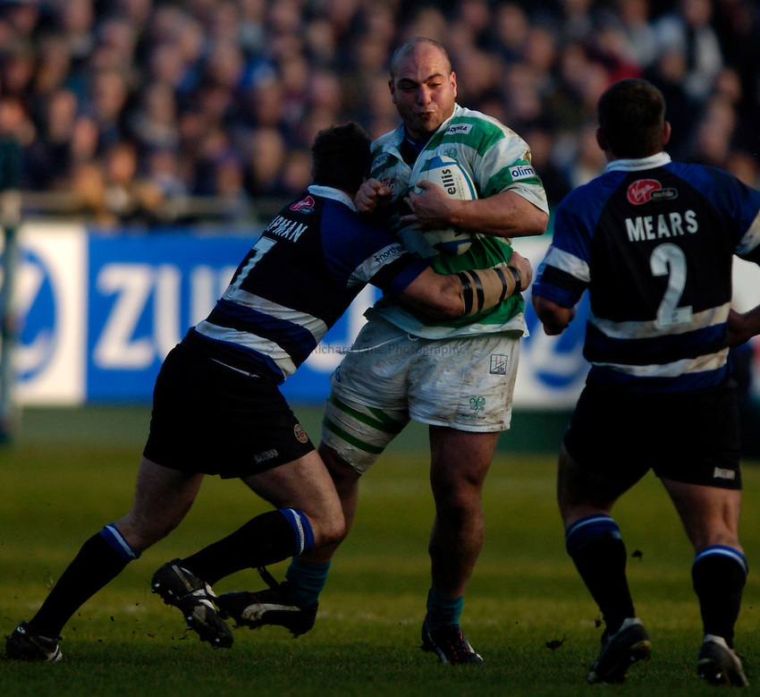 Photo: Richard Lane..Bath Rugby v Benetton Treviso. Heineken Cup. 11/12/2004..Salvatore Costanzo is tackled.