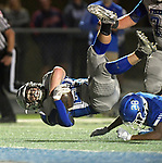 Freeburg's Brennin Kimes falls over Columbia's Londyn Little on this play late in the first half. Freeburg competed at Columbia on Friday September 29, 2018.