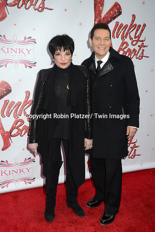 "Liza Minnelli and Michael Feinstein arrive at the ""Kinky Boots"" Broadway Opening on April 4, 2013 at The Al Hirschfeld Theatre in New York City. Harvey Fierstein wrote is the Book Writer and Cnydi Lauper is the Composer."