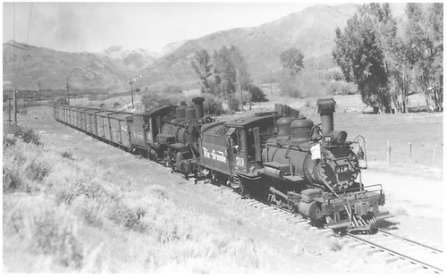 Leased D&amp;RGW #319 and #461 double-heading a freight going into Hesperus.<br /> RGS  Hesperus, CO  Taken by Perry, Otto C. - 9/21/1943