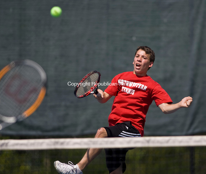 LAKEVILLE, CT - 21 MAY 2010 -052110JT15-<br /> Northwestern's Alex Hill returns the ball to Housatonic's A. J. Opgenorth and Conor McCarthy during a doubles match with Hill's teammate Tyler LeMieux during Friday's Berkshire League Tennis Championship at the Hotchkiss School in Lakeville.<br /> Josalee Thrift Republican-American