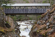 "Sentinel Pine Covered Bridge in Franconia Notch State Park of Lincoln, New Hampshire during the spring months. This footbridge crosses over the Pemigewasset River just above ""The Pool""."