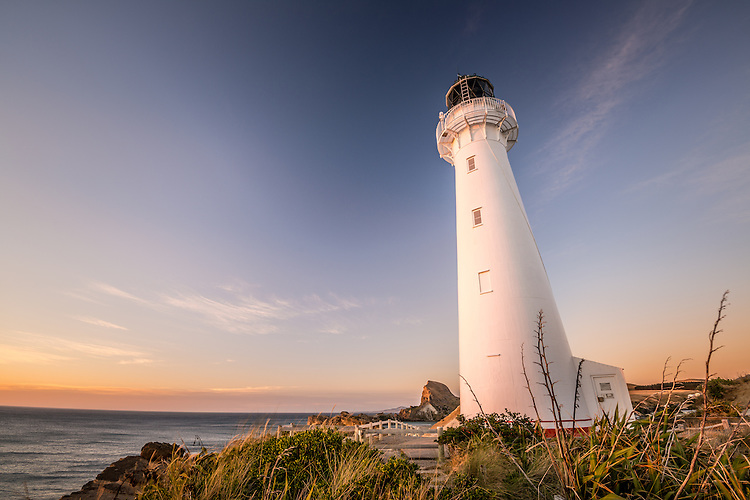 New Zealand landscape image - Sunrise on the lighthouse at Castlepoint, Wairarapa Coast.