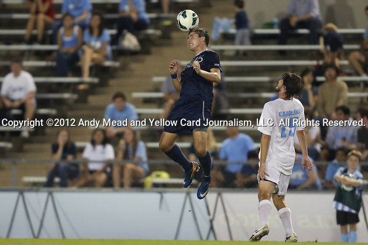 02 October 2012: Georgia Southern's Nick Lane (left) heads the ball as UNC's Cameron Brown (right) watches. The University of North Carolina Tar Heels defeated the Georgia Southern Eagles 2-0 at Fetzer Field in Chapel Hill, North Carolina in a 2012 NCAA Division I Men's Soccer game.