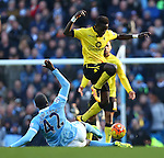 Idrissa Gueye of Aston Villa jumps over a tackle from Yaya Toure of Manchester City - Barclay's Premier League - Manchester City vs Aston Villa - Etihad Stadium - Manchester - 05/03/2016 Pic Philip Oldham/SportImage