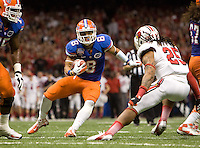 Trey Burton of Florida runs the ball during 79th Sugar Bowl game against Florida at Mercedes-Benz Superdome in New Orleans, Louisiana on January 2nd, 2013.   Louisville Cardinals defeated Florida Gators, 33-23.
