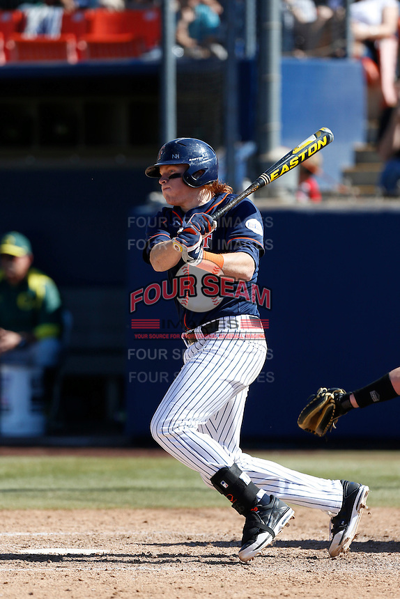 Chad Wallach #29 of the Cal State Fullerton Titans bats against the Oregon Ducks at Goodwin Field on March 3, 2013 in Fullerton, California. (Larry Goren/Four Seam Images)