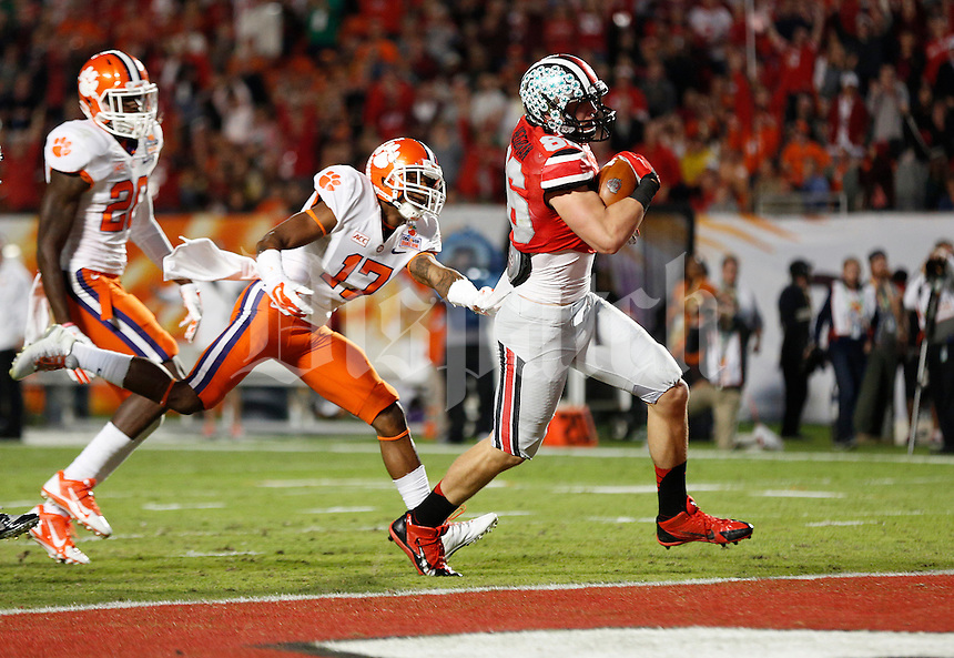 Ohio State Buckeyes tight end Jeff Heuerman (86) runs for a touchdown under pressure from Clemson Tigers defensive back Bashaud Breeland (17) in the second quarter of the Discover Orange Bowl between Ohio State and Clemson at Sun Life Stadium in Miami Gardens, Florida, Friday night, January 3, 2014. As of half time the Ohio State Buckeyes led the Clemson Tigers 22 - 20.(The Columbus Dispatch / Eamon Queeney)