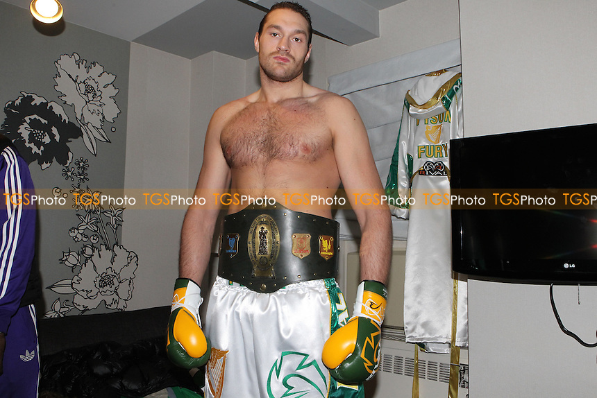 xclusive shots - Tyson Fury poses with his fighting gear in his hotel room in New York, USA, promoted by Main Events / Hennessy Sports - 18/04/13 - MANDATORY CREDIT: Chris Royle/TGSPHOTO - Self billing applies where appropriate - 0845 094 6026 - contact@tgsphoto.co.uk - NO UNPAID USE.