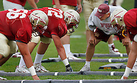 TALLAHASSEE, FLA. 3/26/11-FSU032611 CH-Florida State offensive linemen Trey Pettis, left, and Daniel Foose are scrutinized by Offensive Line Coach Rick Trickett during practice Saturday in Tallahassee..COLIN HACKLEY PHOTO