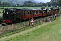 Pictured: Runners take part in race the train. Saturday 18 August 2018<br /> Re: Race the Train is an annual cross country running event that takes place in Tywyn, Mid Wales, UK