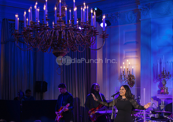 Chrisette Michele performs a song for President Obama, First Lady Michelle Obama, Prime Minister Lee Hsien Loong, Madam Ho Ching during a State Dinner in honor of Prime Minister Lee Hsien Loong in the State Dining Room of the White House in Washington, DC on Tuesday, August 2, 2016. <br /> Credit: Leigh Vogel / Pool via CNP/MediaPunch