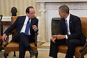United States President Barack Obama, right, meets with President Francois Hollande of France in the Oval Office of the White House in Washington, D.C., U.S., on Tuesday, Feb. 11, 2014. <br /> Credit: Andrew Harrer / Pool via CNP