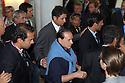 Prime Minister Silvio Berlusconi arrives surrownded by his bodyguards at Grand Hotel Villa d'Este where take place the annual Ambrosetti Workshop in Cernobbio, September 4, 2005. © Carlo Cerchioli