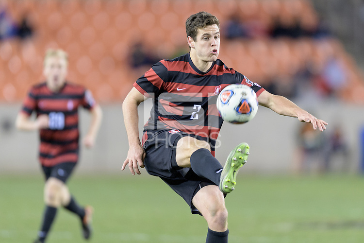 Houston, TX -  Friday, December 9, 2016: Foster Langsdorf (2) of the Stanford Cardinal attempts to gain control of a loose ball against the North Carolina Tar Heels  at the  NCAA Men's Soccer Semifinals at BBVA Compass Stadium.