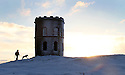 07/12/12 ..Hilary Bridley walks her dog Alfie...As the big freeze continues, dawn breaks over Solomon's Temple (also known as Grinlow Tower) a Victorian Folly near the spa town of Buxton in Derbyshire...All Rights Reserved - F Stop Press.  www.fstoppress.com. Tel: +44 (0)1335 300098.