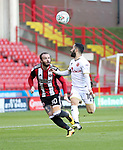 John Brayford of Sheffield Utd in action with Erhun Oztumer of Walsall during the Carabao Cup round One match at Bramall Lane Stadium, Sheffield. Picture date 9th August 2017. Picture credit should read: Jamie Tyerman/Sportimage
