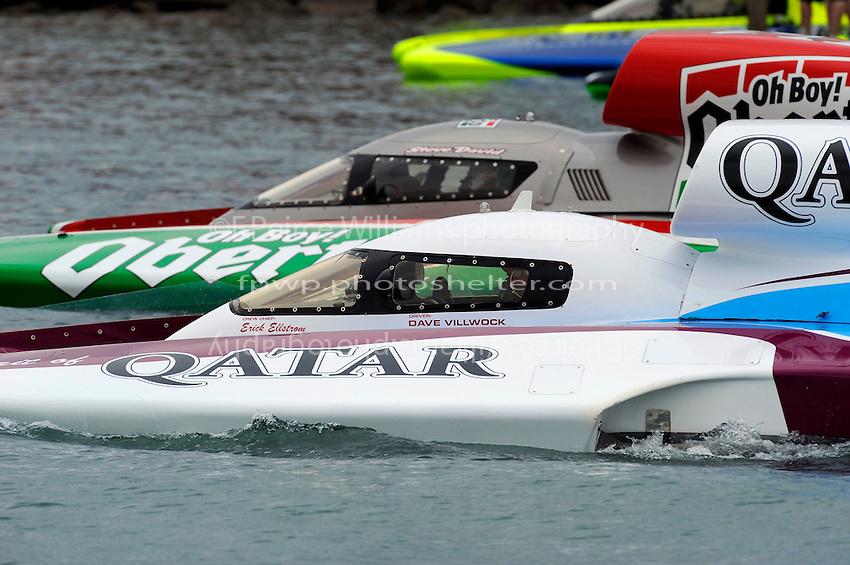 "David Villwock, U-96 ""Spirit of Qatar"" and Steve David, U-1 ""Oh Boy! Oberto"" head out of the pits for testing."