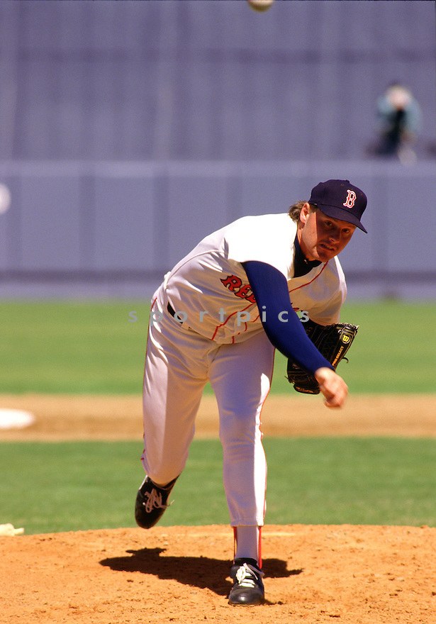 Boston Red Sox Roger Clemens(21) in action during a game from the 1988 season at Fenway Park in Boston, Massachusetts . Roger Clemens  played for 24 years with 4 different teams, was an 11-time All-Star,  a 6-time Cy Young award winner in the American League and a 1-time Cy Young winner in the National League.(SportPics)