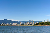 Kitsilano Beach, English Bay, West End high rise buildings and North Shore Mountains on a hot summer day, Vancouver, British Columbia, Canada