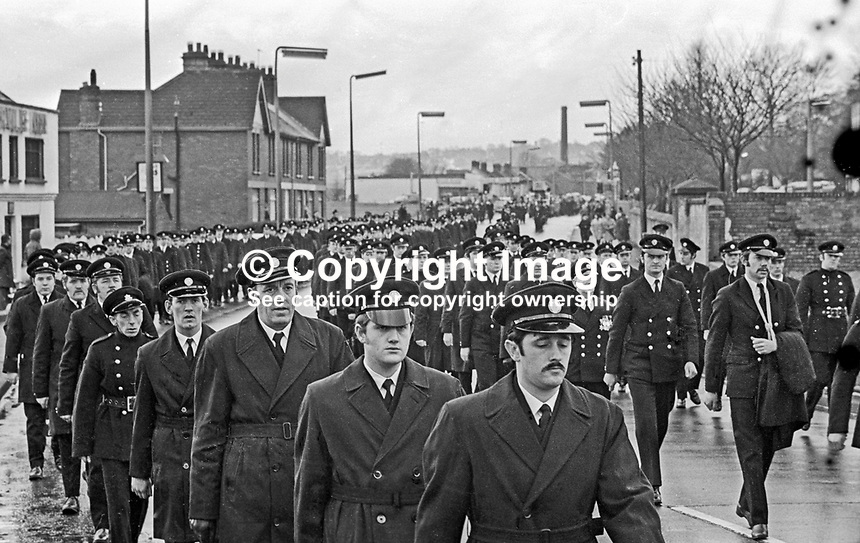 Hundreds of his colleagues follow the funeral of 23 year old Fireman Brian Douglas who was shot dead by the UDA/UFF whilst attending a blaze near the junction of Sandy Row and Lisburn Road in South Belfast. The killing was one of four during a one day general strike on 7th February 1973. Colleagues carry his coffin with his fireman's helmet on top. The funeral was attended by firemen colleagues from all over N Ireland. 197302100085c<br />