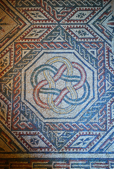 Close up picture of the Roman mosaics of the Room with Star Shaped Decorations depicting a braid geometric mosaic patterns, room no 18 at the Villa Romana del Casale, first quarter of the 4th century AD. Sicily, Italy. A UNESCO World Heritage Site.
