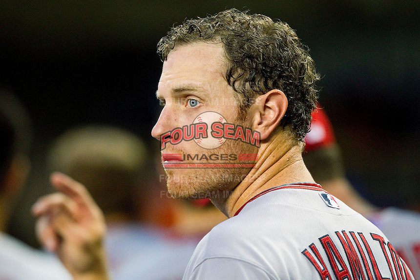 Josh Hamilton (32) of the Los Angeles Angels looks out at the field after scoring a run against the Detroit Tigers at Comerica Park on June 25, 2013 in Detroit, Michigan.  The Angels defeated the Tigers 14-8.  (Brian Westerholt/Four Seam Images)