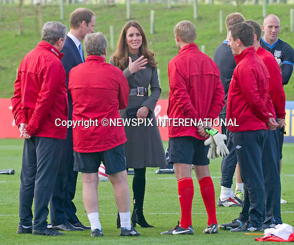 """CATHERINE, DUCHESS OF CAMBRIDGE AND PRINCE WILLIAM.attend the opening of St. George's Park, the Football Association's National Football Centre, Burton-Upon-Trent..Their Royal Highnesses were given a tour of the main facilities on the 330-acre site and also met England Manager Roy Hodgson and his squad as they trained at St. George's Park for the first time_09/10/2012.Mandatory credit photo: ©Dias/NEWSPIX INTERNATIONAL..(Failure to credit will incur a surcharge of 100% of reproduction fees)..                **ALL FEES PAYABLE TO: """"NEWSPIX INTERNATIONAL""""**..IMMEDIATE CONFIRMATION OF USAGE REQUIRED:.DiasImages, 31a Chinnery Hill, Bishop's Stortford, ENGLAND CM23 3PS.Tel:+441279 324672  ; Fax: +441279656877.Mobile:  07775681153.e-mail: info@newspixinternational.co.uk"""