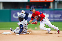 Shortstop Jose Iglesias #10 of the Pawtucket red Sox can't handle the throw as Donny Lucy #4 of the Charlotte Knights slides into second base at McCoy Stadium on June 12, 2011 in Pawtucket, Rhode Island.  The Red Sox defeated the Knights 2-1.    Photo by Brian Westerholt / Four Seam Images